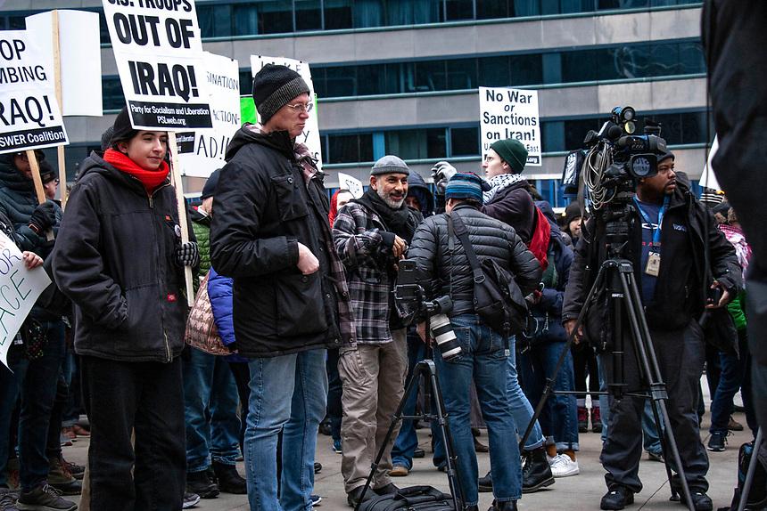 March through downtown Chicago demanding no war against Iran.