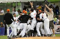 10 March 2009: Team Netherlands celebrate after #21 Eugene Kingsale  scores the winning run against the Dominican Republic in the eleventh inning during the 2009 World Baseball Classic Pool D game 5 at Hiram Bithorn Stadium in San Juan, Puerto Rico. The Netherlands pulled off second upset to advance to the secound round. The Netherlands come from behind in the bottom of the 11th inning and beat the Dominican Republic, 2-1.