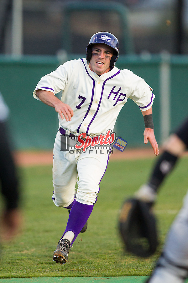 Dane McDermott (7) of the High Point Panthers hustles towards home plate on his way to scoring a run against the Coastal Carolina Chanticleers at Willard Stadium on March 15, 2014 in High Point, North Carolina.  (Brian Westerholt/Sports On Film)