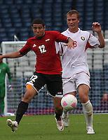Men's Olympic Football match Egypt v Belarus on 1.8.12...Eslam Ramadan of Egypt and Sergei Kornilenko of Belarus, during the Men's Olympic Football match between Egypt v Belarus at Hampden Park, Glasgow.