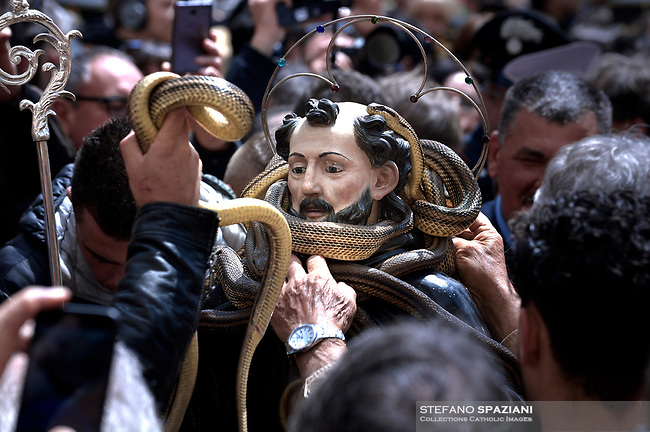 "A statue of Saint Domenico surrounded by live snakes is held up by worshippers during an annual procession dedicated to the saint, in the streets of Cocullo, in the Abruzzo region, on May 1, 2019.<br /> <br /> <br /> <br /> The St. Domenico's procession in Cocullo, central Italy. Every year on the first  of May, snakes are placed onto the statue of St. Domenico and then the statue is carried in a procession through the town. St. Domenico is believed to be the patron saint for people who have been bitten by snakes:<br /> <br /> Italy, Cocullo, in the Province of L'A...quila, is at 870 meters a.s.l., along the railway line connecting Sulmona to Rome. The village rises alongside Mount Luparo (1327 meters) ""The valley opening in front of the village is surrounded by bare rocks, while on the other side, to the south, snow-capped mountain crests follow one after the other...""<br /> San Domenico Abate lived in the 10th and 11th centuries AD. Born in Foligno, in the Umbria region, he started his pilgrimages, preaching and ascetic practices in Central Italy, making miracles recorded by the word-of-mouth tradition. He died on 22 January 1031 and was buried in Sora.<br /> <br /> Cocullo snake charmers are over with their snake hunting. They proceeded through the During the procession on the first in May, before the snakes are placed all over the statue of St. Dominick, they will be fed with milk kept in containers with crusca. It is the snake that, most of all other elements, expresses an ancestral myth: the unknown aspect and unpredictability of the natural environment with man's innate need to achieve the dominance on his own habitat. <br /> <br /> Snakes and wolves were the emblems of Italic peoples like the Marsians and Irpinians. Some areas in Abruzzo, especially in the Sagittario valley, were under the menace of wolves and snakes, which for the local populations represented the uncertainty and anxiety of their existence that, together with the precariousness and hardships of life, were almost unbearable. Therefore the community adopted"