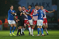 Stevenage players surround the referee after a foul by Dan Butler of Peterborough United on Elliott List of Stevenage during Stevenage vs Peterborough United, Emirates FA Cup Football at the Lamex Stadium on 9th November 2019