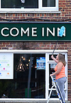 Welcome Back - Come In - Super Saturday<br /> <br /> Pictured: Landlady Hannah Last, 28, of the Welcome Inn in Eastleigh, Hampshire cleans the pub sign in readiness for the reopening of her pub.  <br /> <br /> Pubs around the UK have been given the go-ahead to open as of tomorrow, Saturday 4th July, however Greene King have decided they'll re-open over 1,000 of their managed pubs as of Monday 6th July, with the remaining one third opening in a second phase.<br /> <br /> NOTE:  The Welcome Inn is a Greene King pub, one of those opening Monday.<br /> <br /> © Simon Czapp/Solent News & Photo Agency<br /> UK +44 (0) 2380 458800