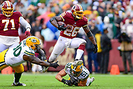 Landover, MD - September 23, 2018: Washington Redskins running back Adrian Peterson (26) jumps over Green Bay Packers linebacker Kyler Fackrell (51) on his way to a first down during game between the Green Bay Packers and the Washington Redskins at FedEx Field in Landover, MD. The Redskins get the win 31-17 over the visiting Packers. (Photo by Phillip Peters/Media Images International)