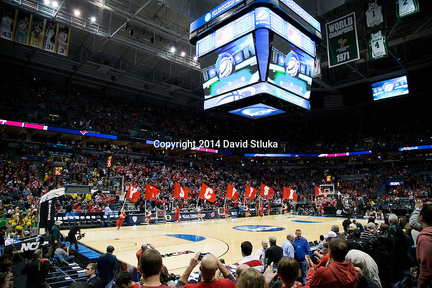 Wisconsin Badgers cheerleaders lead the team out during the third-round game in the NCAA college basketball tournament against the Oregon Ducks Saturday, April 22, 2014 in Milwaukee. The Badgers won 85-77. (Photo by David Stluka)