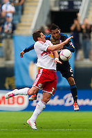 Kenny Cooper (33) of the New York Red Bulls  goes up for a header with Carlos Valdes (2) of the Philadelphia Union. The New York Red Bulls defeated the Philadelphia Union 3-0 during a Major League Soccer (MLS) match at PPL Park in Chester, PA, on October 27, 2012.