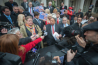 Businessman John A. Catsimatidis, center, joined by family and supporters, announces his run for Mayor of the City of New York as a Republican on the steps of City Hall in New York on Tuesday, January 29, 2013. Catsimatidis is most familiar to New Yorkers as the owner of loved and loathed Gristedes supermarket chain but has business interests in a myriad of other endeavors. (© Richard B. Levine)
