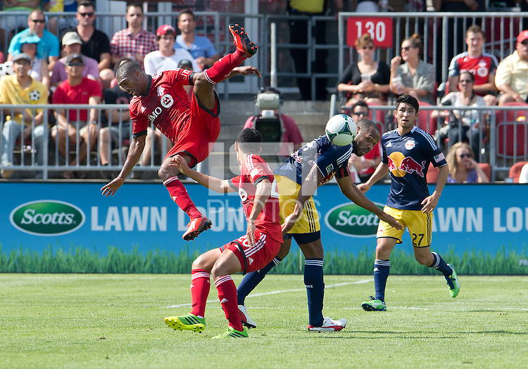 20 July 2013: Toronto FC defender Ashtone Morgan #5 and Toronto FC midfielder Matias Laba #20 battle with New York Red Bulls forward Thierry Henry #14 during an MLS regular season game between the New York Red Bulls and Toronto FC at BMO Field in Toronto, Ontario Canada.