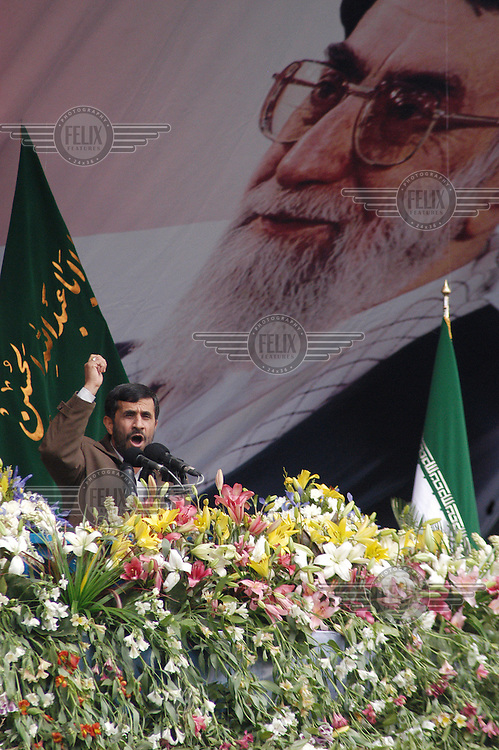 President Mahmoud Ahmadinejad makes a speech at a celebration to mark the 28th anniversary of the Islamic revolution, beneath a poster of Iran's supreme leader Ali Khamenei.