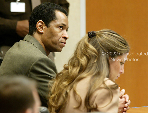 Sniper suspect John Allen Muhammad, left, listens to testimony along with his attorney Christie Leary, right, during his trial in Virginia Beach Circuit Court in Virginia Beach, Virginia on November 9, 2003.  The prosecution rested it's case. <br /> Credit: Tracy Woodward - Pool via CNP