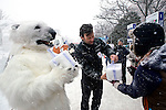 Kamiel Verschuren and Mami Odai (in polar bear outfit) hand out blocks of compacted snow to passerby during the Sapporo Snow Festival in Sapporo City, northern Japan on 05 Feb. 2010.