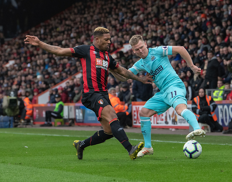 Newcastle United's Matt Ritchie (right) is tackled by Bournemouth's Jordon Ibe (left)  <br /> <br /> Photographer David Horton/CameraSport<br /> <br /> The Premier League - Bournemouth v Newcastle United - Saturday 16th March 2019 - Vitality Stadium - Bournemouth<br /> <br /> World Copyright © 2019 CameraSport. All rights reserved. 43 Linden Ave. Countesthorpe. Leicester. England. LE8 5PG - Tel: +44 (0) 116 277 4147 - admin@camerasport.com - www.camerasport.com