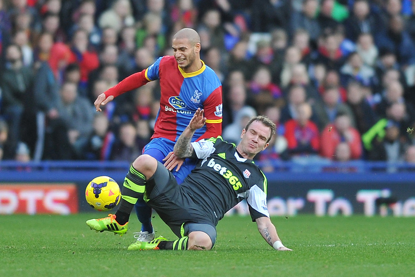 Crystal Palace's Adlene Guedioura is tackled by Stoke City's Glenn Whelan<br /> <br /> Photo by Ashley Western/CameraSport<br /> <br /> Football - Barclays Premiership - Crystal Palace v Stoke City - Saturday 18th January 2014 - Selhurst Park - London<br /> <br /> &copy; CameraSport - 43 Linden Ave. Countesthorpe. Leicester. England. LE8 5PG - Tel: +44 (0) 116 277 4147 - admin@camerasport.com - www.camerasport.com