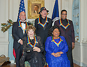 The five recipients of the 2013 Kennedy Center Honors pose for a photo following a dinner hosted by United States Secretary of State John F. Kerry at the U.S. Department of State in Washington, D.C. on Saturday, December 1, 2013.  Seated in the front row, from left, are: Shirley MacLain, and Martina Arroyo. Standing, from left, are Billy Joel, Carlos Santana, and Herbie Hancock.  The 2013 honorees are opera singer Martina Arroyo; pianist, keyboardist, bandleader and composer Herbie Hancock; pianist, singer and songwriter Billy Joel; actress Shirley MacLaine; and musician and songwriter Carlos Santana.  <br /> Credit: Ron Sachs / CNP