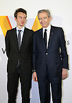 """April 21, 2016, Tokyo, Japan - French luxury brand group LVMH chairman and CEO Bernard Arnault (R) smiles with his son Antoine during a photo call for the reception of Louis Vuitton's art exhibition in Tokyo on Thursday, April 21, 2016. French luxury barnd Luis Vuitton will hold the exhibition """"Volez, Voguez, Voyagez"""" in Tokyo from April 23 through June 19.  (Photo by Yoshio Tsunoda/AFLO) LWX -ytd-"""