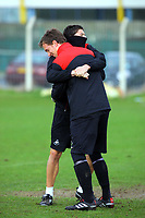 Pictured: Federico Bessone hugs goalkeeper Dorus de Vries (FRONT) Thursday 01 April 2010<br /> Re: Swansea City Football Club training at Llandarcy near near Swansea south Wales ahead of their clash against Cardiff on Saturday.