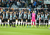 9th November 2019; St James Park, Newcastle, Tyne and Wear, England; English Premier League Football, Newcastle United versus AFC Bournemouth;  Newcastle United players link arms during the minutes silence to commemorate Armistice day - Strictly Editorial Use Only. No use with unauthorized audio, video, data, fixture lists, club/league logos or 'live' services. Online in-match use limited to 120 images, no video emulation. No use in betting, games or single club/league/player publications