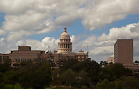 USA and Republic of Texas State Flags fly along the Texas State Capitol