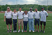 "Members of the 2013 USA Track and Field Youth World Championships staff pose for a photo after being introduced on the final day of the combined USATF Youth World Trials and Youth Outdoor Championships, Sunday, June 30, in Edwardsville, Il. Members include Lee Webb, Erika Bartolina, Martin Provincia?, Lisa Morgan, Anthony ""A.J."" James, Brandon Jiles and Cliff Mckenzie,"