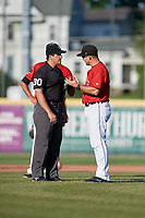 Erie SeaWolves manager Mike Rabelo (58) argues a call with umpire Mike Savakinas during an Eastern League game against the Richmond Flying Squirrels on August 28, 2019 at UPMC Park in Erie, Pennsylvania.  Richmond defeated Erie 6-4 in the first game of a doubleheader.  (Mike Janes/Four Seam Images)