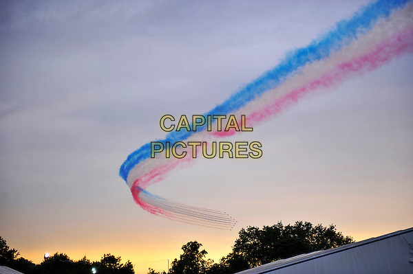 The Red Arrows.Flying in formation over Hyde Park on as part of the London 2012 Olympic Games opening Ceremony, London, England, UK, July 27th 2012..gv general view planes aircraft red white and blue vapor smoke trial sky patriotic british .CAP/MAR.© Martin Harris/Capital Pictures.