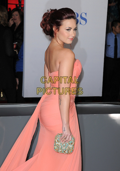 Demi Lovato.People's Choice Awards 2012 held at Nokia Live in Los Angeles, California, USA..January 11th, 2012.half side length orange coral pink beads beaded clutch bag strapless dress     .CAP/RKE/DVS.©DVS/RockinExposures/Capital Pictures.