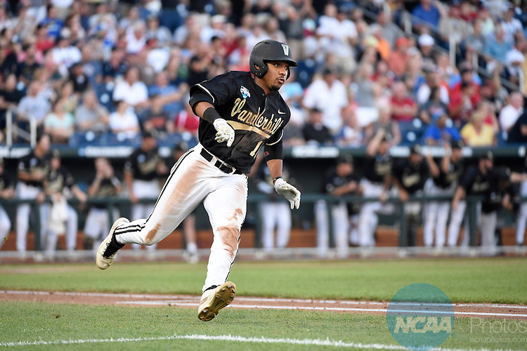 24 JUNE 2014:  John Norwood (10) of Vanderbilt University hits a double against the University of Virginia during the Division I Men's Baseball Championship held at TD Ameritrade Park in Omaha, NE.  Virginia defeated Vanderbilt 7-2 in Game Two of the championship series to force a Game Three.  Jamie Schwaberow/NCAA Photos