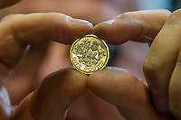 Tuesday 28 February 2017<br /> Pictured: A worker inspects the new one pound coin <br /> Re: The Royal Mint in Llantrisant is producing the new one pound coin