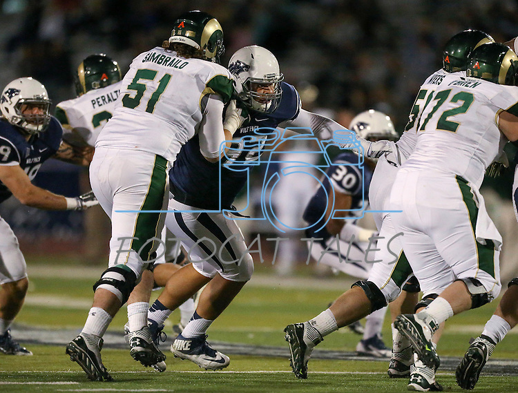 Colorado State lineman Ty Sambrilo (51) and Nevada's Jordan Hanson (92) compete during the second half of an NCAA college football game in Reno, Nev., on Saturday, Oct. 11, 2014. Colorado State won 31-24. (AP Photo/Cathleen Allison)