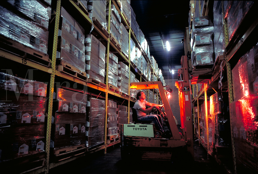 Warehouse worker on forklift.