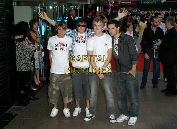 "McFLY - DOUGIE POYNTER, DANNY JONES, TOM FLETCHER & HARRY JUDD.""Superman Returns"" UK film premiere, Odeon Leicester Square, London, UK..July 13th, 2006.ReF: AH.full length sport relief jeans denim camouflage arms outstretched.www.capitalpictures.com.sales@capitalpictures.com.© Capital Pictures."