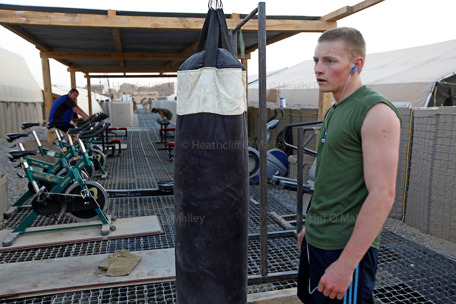 Mcc0018106 . SundayTelegraph..A soldier using the open-air gym in FOB Shawqat in the Nad e'Ali district of Helmand Province...Afghanistan 7 November 09