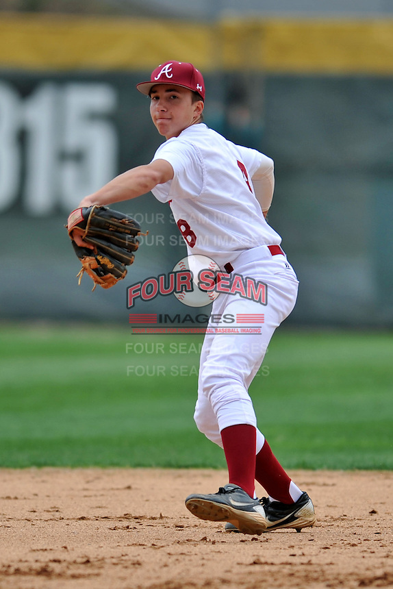Asheville Cougars shortstop David Head #8 fields and throws throws to first during a game against the T.C. Roberson Rams  at Asheville High on April 15, 2013 in Asheville, North Carolina. The Rams won 4-1. (Tony Farlow/Four Seam Images).