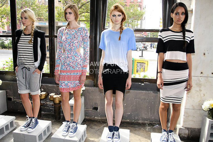 Models pose in outfits from the Pencey Standard Spring Summer 2013 collection by Christina Minasian, during New York Fashion Week, September 6, 2012