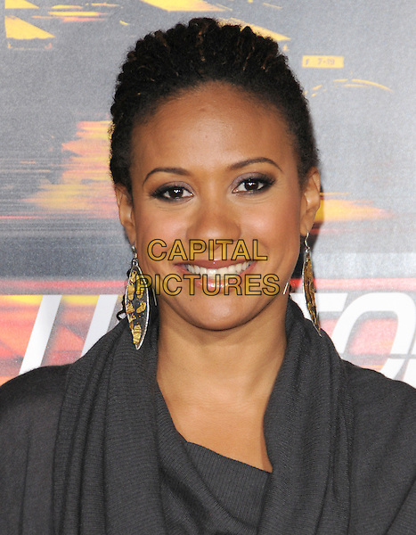 "TRACIE THOMS .attends the Twentieth Century Fox's L.A. Premiere of ""Unstoppable"" held at Regency Village Theater in Westwood, California, USA, October 26th 2010..portrait headshot smiling earrings dangly  grey gray cowel neck top .CAP/RKE/DVS.©DVS/RockinExposures/Capital Pictures."