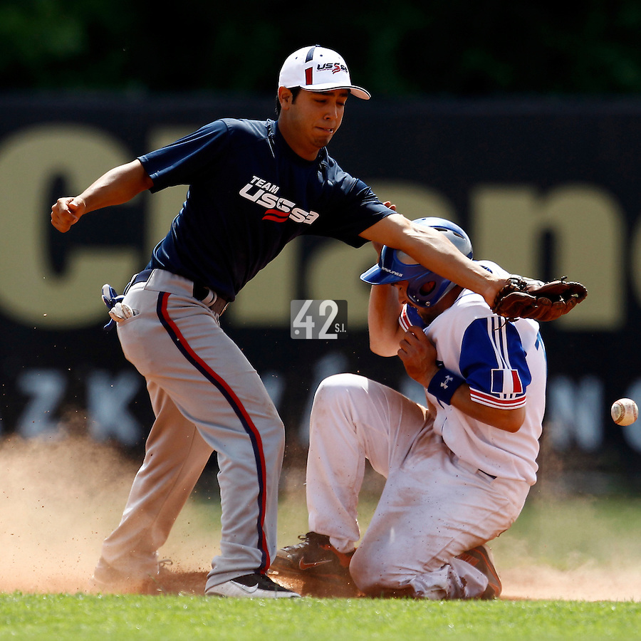23 June 2011: Florian Peyrichou of Team France slides safely into second base during USSSA 5-3 win over France, at the 2011 Prague Baseball Week, in Prague, Czech Republic.