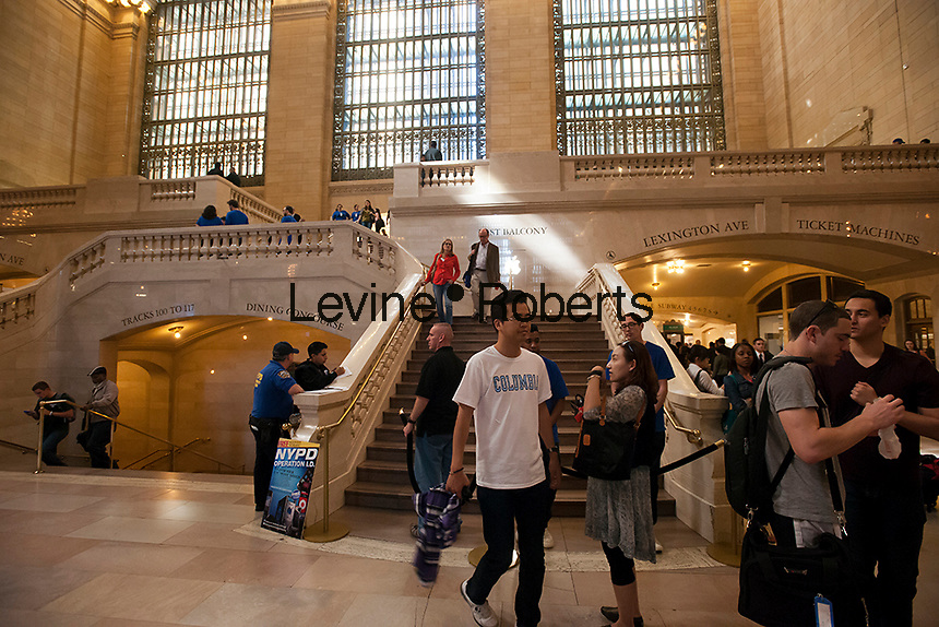 The Apple store in Grand Central Terminal  on Friday, September 21, 2012.  The fifth generation of Apple's iPhone, the iPhone 5,  went on sale today bringing crowds and lines to Apple stores around the world. (© Richard B. Levine)