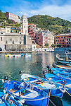 Small fishing boats moored in the pretty seaside town of Vernazza in Cinque Terre in Italy.