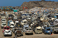 Cars are piled up from the town of Natori that was completely devastated during the March 11th Tsunami in Japan.  The small coastal town was swept away most of it ending up in the rice field a kilometer away.  Now 100 days after the tsunami most of the fields have been cleared of debris and the town has been cleared.  Next to the coast a huge pile of thousands of tonnes of debris, mounting to the entire village, is piled up on the coast, next too hundreds of mangles cars.<br /> 16 May 2011<br /> photo by Richard Jones  / Sinopix