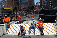 New York, USA. 1st May 2014.  Workers take a break during their work in Lower Manhattan. Eduardo MunozAlvarez/VIEWpress