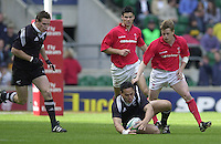 25/05/2002 (Saturday).Sport -Rugby Union - London Sevens.Wales vs New Zealand.Chris Masoe collects the ball, Arwel Thomas  (R)[Mandatory Credit, Peter Spurier/ Intersport Images].
