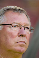 Manchester United head coach Sir Alex Ferguson watches his team before a friendly match at Lincoln Financial Field in Philadelphia, Pennsylvania.  Manchester United defeated Philadelphia Union, 1-0.