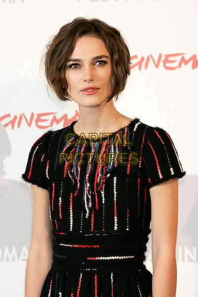 KEIRA KNIGHTLEY (wearing a Chanel dress and jewelry).Photocall for 'Last Night', Rome International Film Festival, Rome, Italy.October 28th, 2010.half length dress black red white beads beaded  .CAP/PE.©Peter Eden/Capital Pictures.
