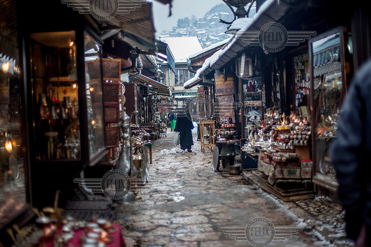 A woman walking through the Quarter Bascarsija, Sarajevo's old bazaar and the historical and cultural centre of the capital.