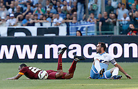 Calcio, Serie A: Lazio vs Roma. Roma, stadio Olimpico, 25 maggio 2015.<br /> Roma's Seydou Keita, left, lies on the pitch after being fouled by Lazio's Santiago Gentiletti during the Italian Serie A football match between Lazio and Roma at Rome's Olympic stadium, 25 May 2015.<br /> UPDATE IMAGES PRESS/Riccardo De Luca