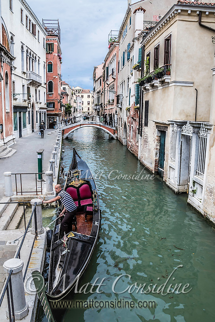 An iconic scene of a gondolier docking in Venice. (Photo by Travel Photographer Matt Considine)