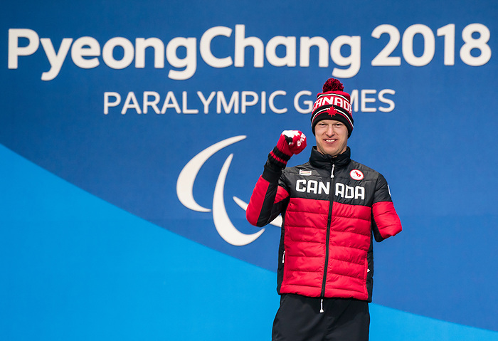 PyeongChang 16/3/2018 - Mark Arendz collects his gold medal in the men's biathlon 15km standing during the medal ceremony at the PyeongChang Olympic Plaza during the 2018 Winter Paralympic Games in Pyeongchang, Korea. Photo: Dave Holland/Canadian Paralympic Committee
