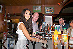 Celebrity model Georgia Salpa pulling a drink at the Mermaids Bar, Listowel with proprietor Liam Flaherty giving a helping hand.