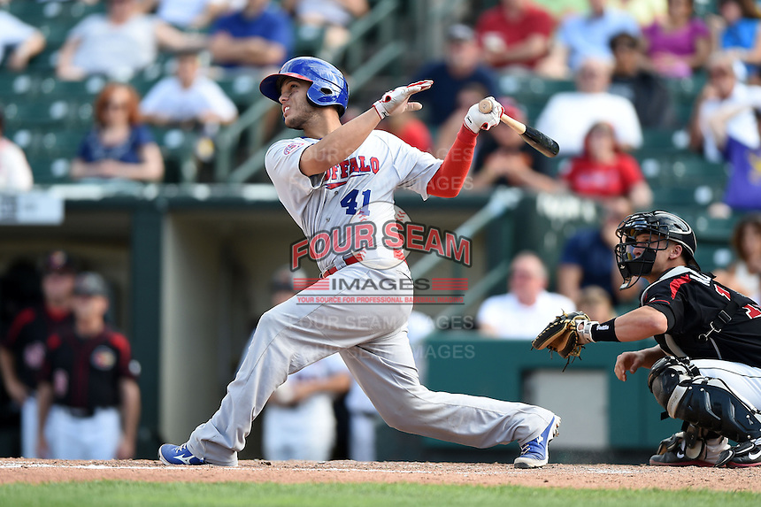 Buffalo Bisons catcher A.J. Jimenez (41) hits a solo home run during the first game of a doubleheader against the Rochester Red Wings on July 6, 2014 at Frontier Field in Rochester, New  York.  Rochester defeated Buffalo 6-1.  (Mike Janes/Four Seam Images)