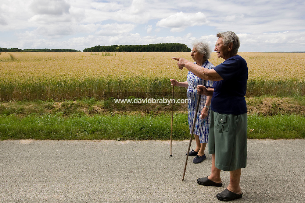 Two ladies on a walk point to riders (not seen) participating in a Backroads cycle tour of the Loire Valley in France, 25 June 2008.